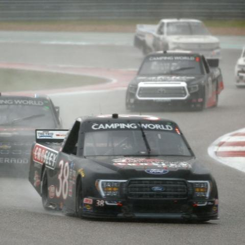 Todd Gilliland (38) won the first stage and ultimately the race after overcoming an early race penalty in the Toyota Tundra 225 at Circuit of The Americas Saturday near Austin, Texas. The race started in the rain and teams used wet weather tires throughout the entire 41-lap race around the 3.41-mile, 20-turn road course.